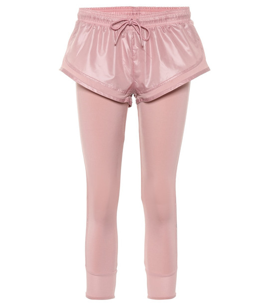 Adidas by Stella McCartney Essentials shorts over tights in pink