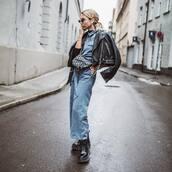 jumpsuit,blue jumpsuit,lace up boots,platform boots,black pants,dior bag,black leather jacket,h&m