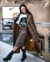 coat,plaid,oversized,black boots,lace up boots,midi skirt,plaid skirt,bucket bag,brown bag,sweater,knit