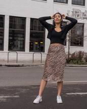 skirt,midi skirt,tiger print,white sneakers,black top,black cardigan,cropped