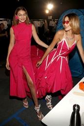 dress,gigi hadid,bella hadid,hadid sisters,celebrity,model,fashion week,red dress,red,asymmetrical,asymmetrical dress