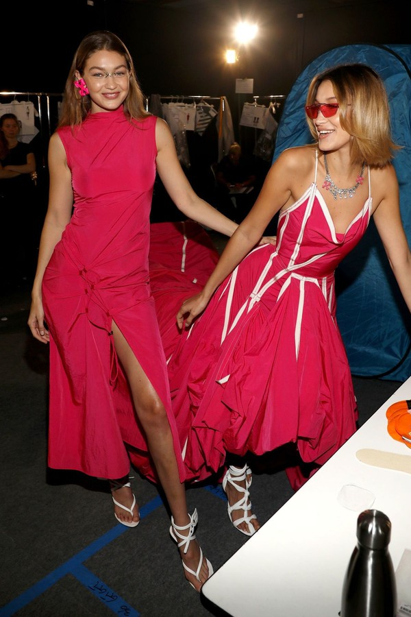dress gigi hadid bella hadid hadid sisters celebrity model fashion week red dress red asymmetrical asymmetrical dress