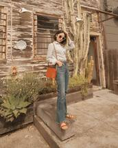 top,shirt,striped shirt,flare jeans,high waisted jeans,brown bag,flat sandals
