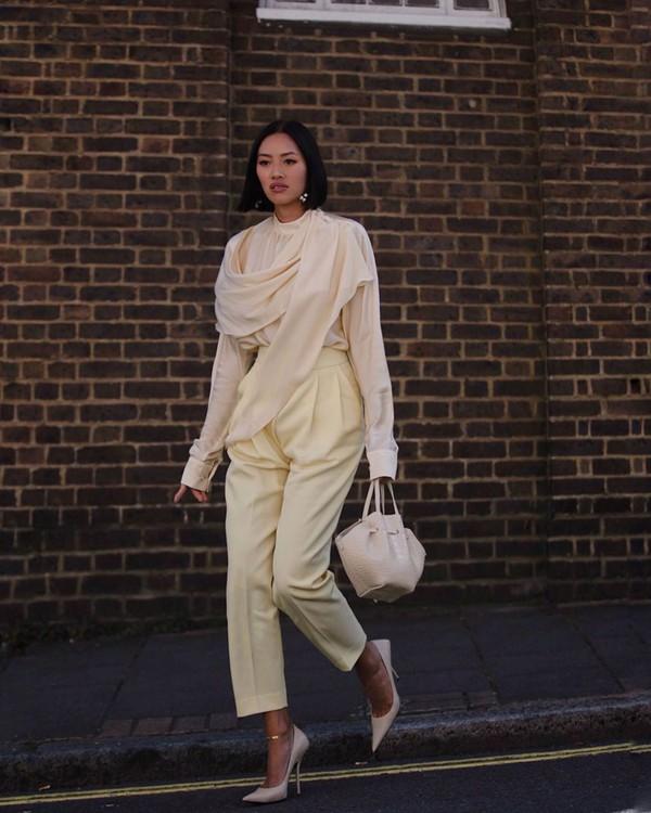 top turtleneck blouse high waisted pants pleated pumps handbag