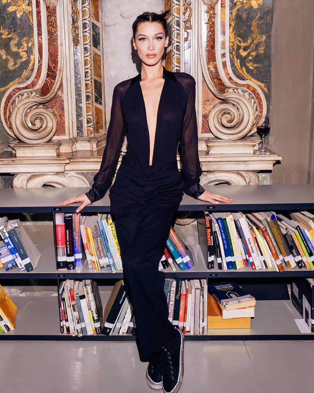 pants black top plunge v neck bella hadid model off-duty fashion week