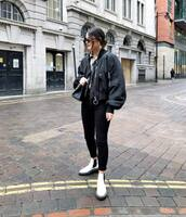 shoes,white boots,ankle boots,black skinny jeans,black jacket,bomber jacket,black bag,shirt