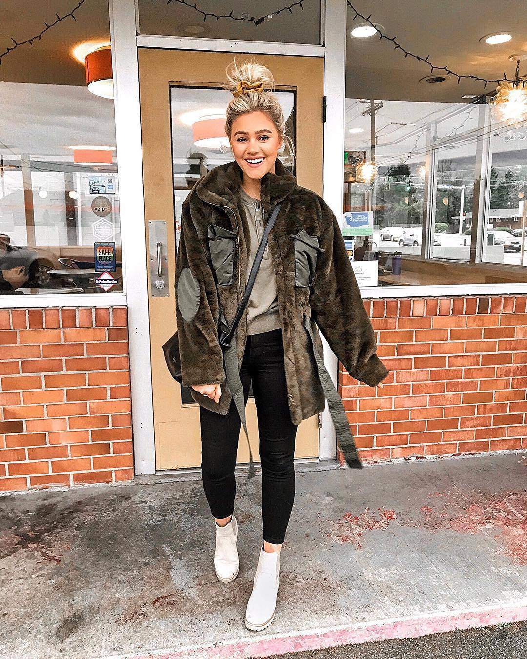 jacket faux fur jacket white boots ankle boots black skinny jeans top long sleeves black bag crossbody bag
