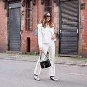 pants,white pants,flare pants,high waisted pants,white boots,black bag,white jacket,white top