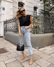 top,black t-shirt,high waisted jeans,sandal heels,prada bag