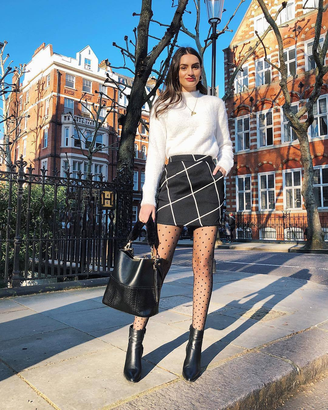sweater white sweater fluffy mini skirt black skirt tights ankle boots black boots black bag