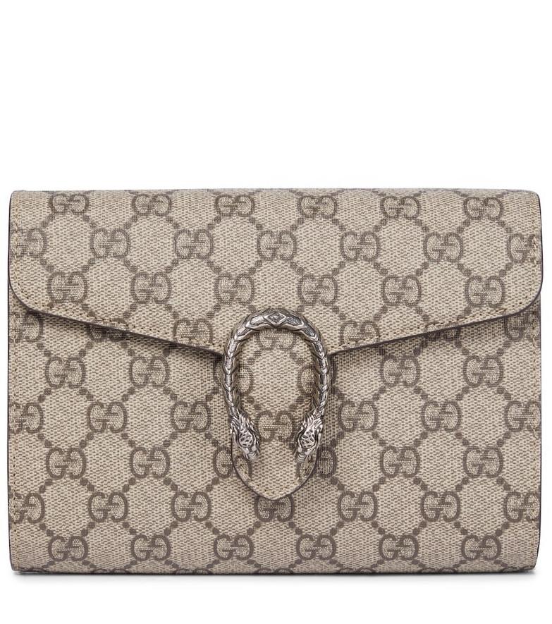Gucci Dionysus GG Supreme clutch in beige