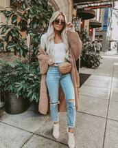 sweater,long cardigan,oversized cardigan,white boots,ankle boots,ripped jeans,belt bag,white top