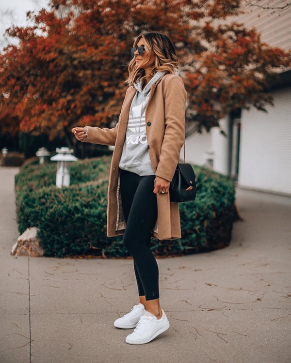 coat white sneakers black leggings hoodie black bag