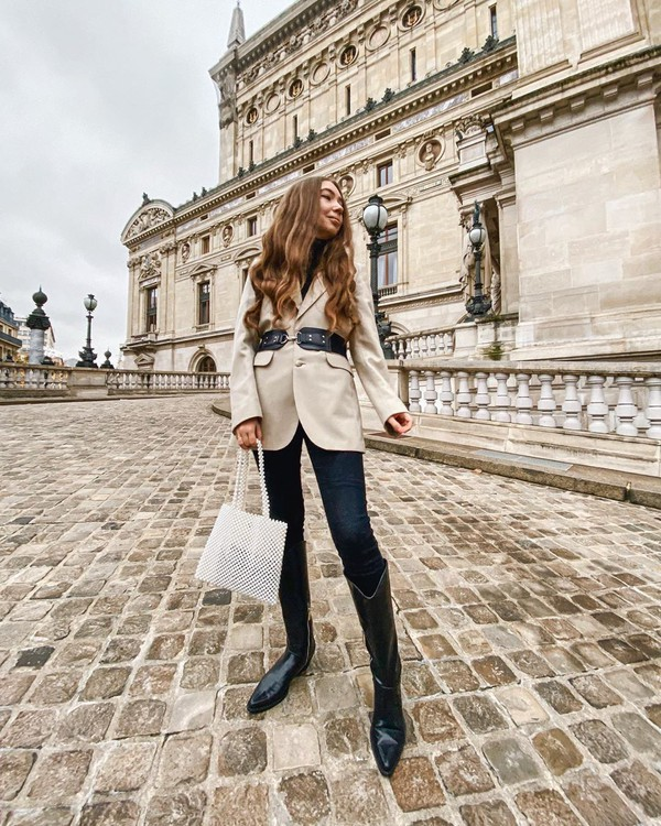 jacket blazer knee high boots black boots skinny jeans white bag black turtleneck top