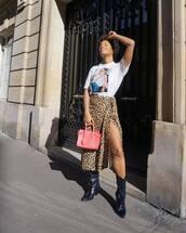 skirt,midi skirt,leopard print,slit skirt,black boots,cowboy boots,handbag,pink bag,white t-shirt