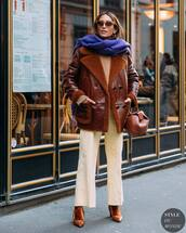 pants,white pants,brown boots,brown jacket,leather jacket,handbag,brown bag,sweater,scarf