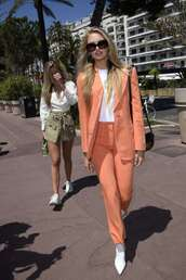 jacket,romee strijd,model off-duty,spring outfits,suit,pants,top,blazer,orange