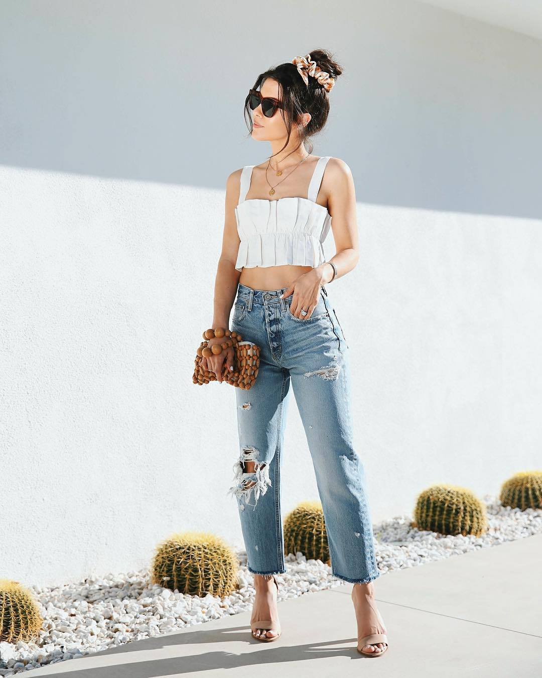 top crop tops white top ripped jeans high waisted jeans cropped jeans sandal heels wood handbag