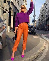 pants,leather pants,orange,pumps,sweater,bag
