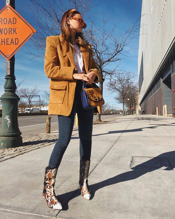 shoes heel boots leather boots snake print skinny jeans mustard coat handbag J.W.Anderson bag white top