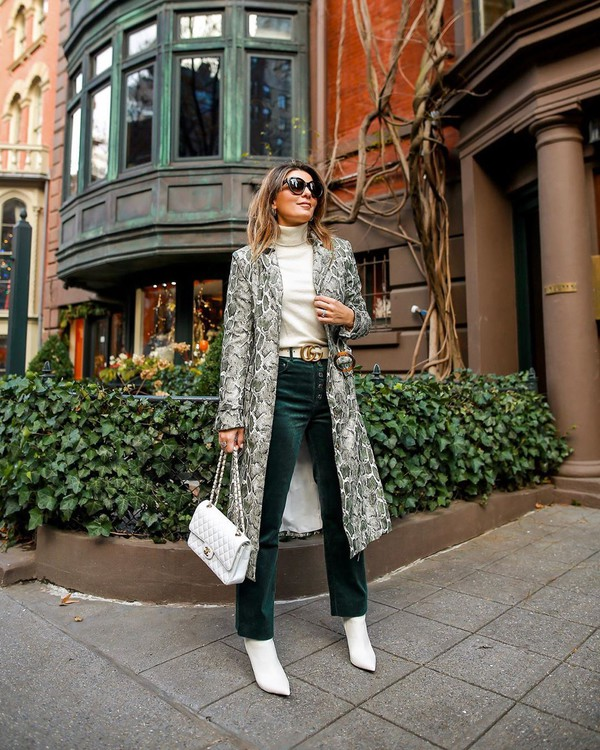 coat long coat snake print white boots straight pants white bag white turtleneck top