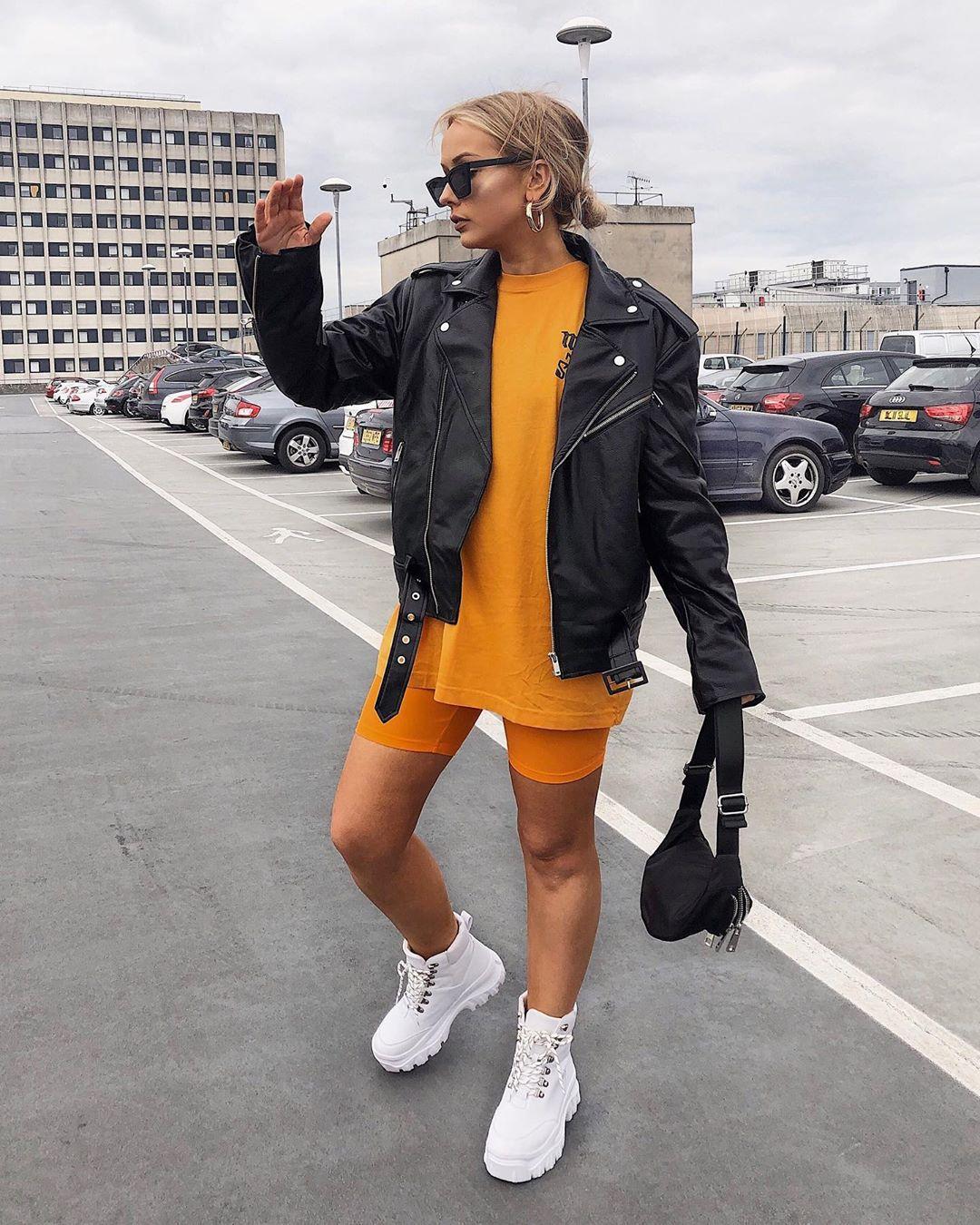 shorts short orange t-shirt black leather jacket belt bag white boots ankle boots