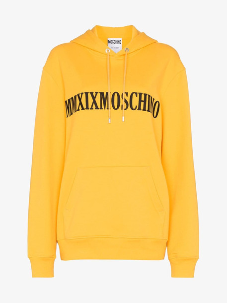 Moschino logo printed oversized hoodie in yellow