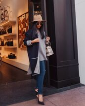 sweater,grey sweatpants,slingbacks,skinny jeans,navy coat,oversized coat,handbag,hat