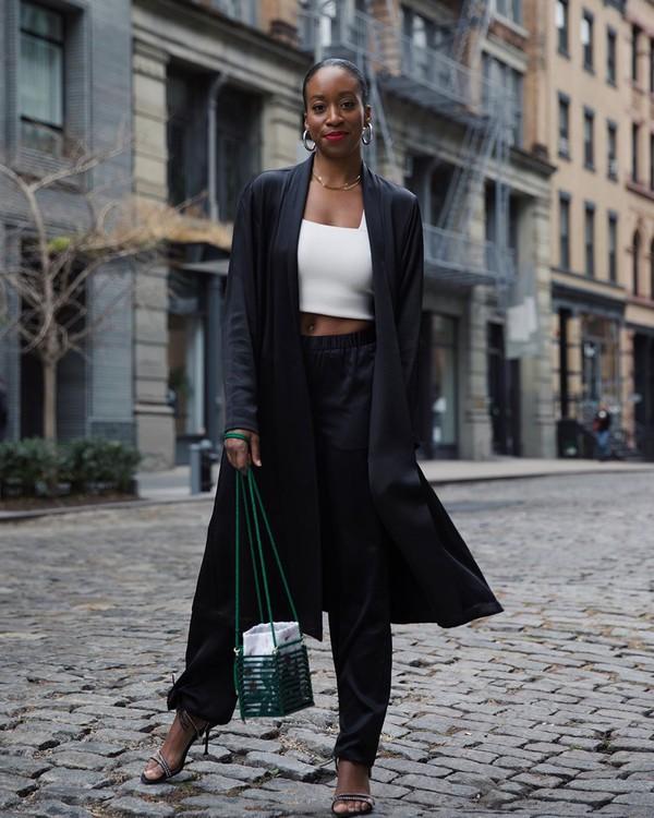 coat black coat bucket bag black sandals black pants white top crop tops