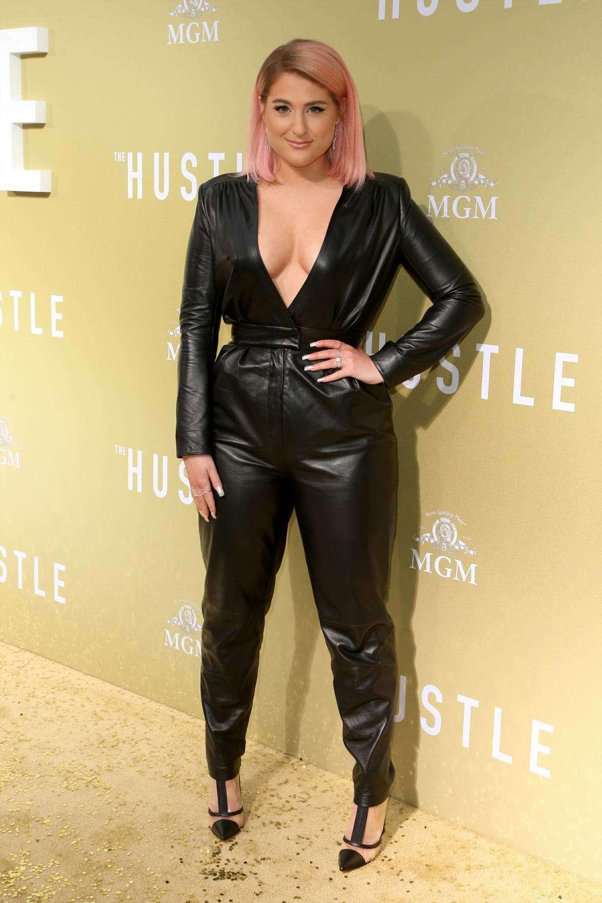 jumpsuit meghan trainor celebrity pants plunge v neck top pumps black leather leather pants