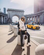 scarf,fur scarf,white boots,black leather pants,straight pants,handbag,black bag,black coat,black sunglasses