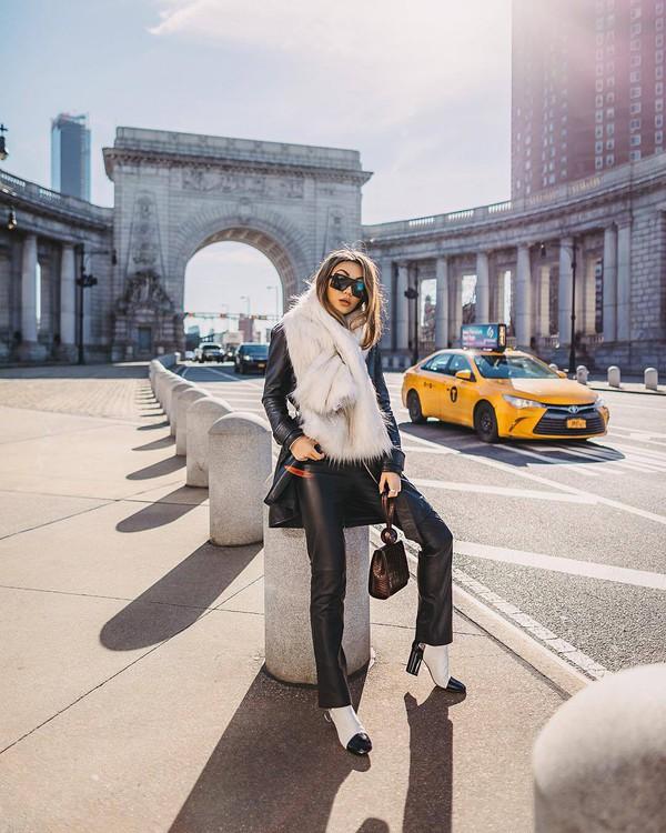 scarf fur scarf white boots black leather pants straight pants handbag black bag black coat black sunglasses