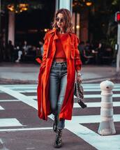 coat,trench coat,orange coat,long coat,michael kors,black boots,combat boots,skinny jeans,high waisted jeans,black bag,cropped sweater