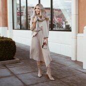 skirt,pleated skirt,asymmetrical skirt,high waisted skirt,midi skirt,heel boots,suede boots,knitted sweater,scarf