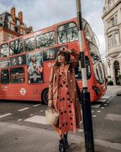 dress,floral dress,midi dress,black boots,ankle boots,handbag,trench coat,vinyl