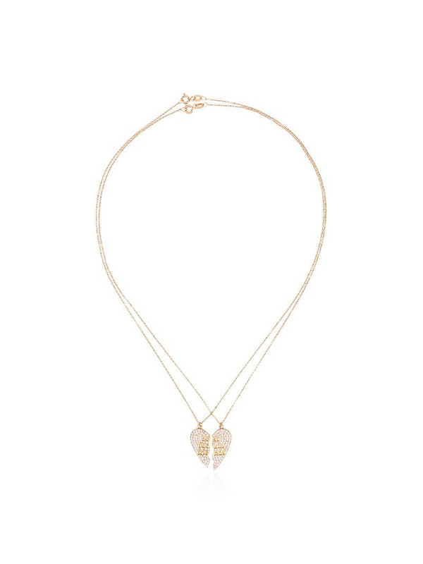 Established 18kt yellow gold two piece heart necklace with diamonds in metallic