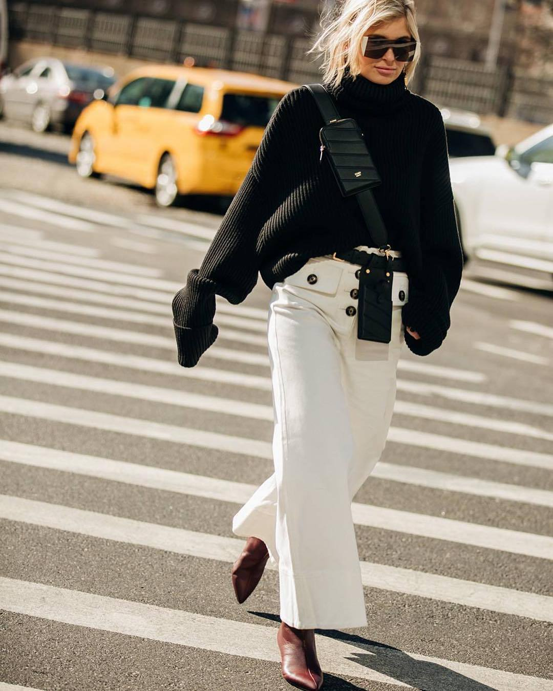 sweater turtleneck sweater black sweater oversized sweater wide-leg pants white pants high waisted pants red boots