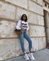 shoes,white sneakers,ripped jeans,high waisted jeans,sweatshirt,louis vuitton bag
