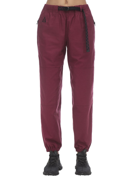 NIKE ACG Acg Woven Pants in red