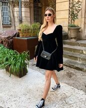 dress,black dress,velvet dress,long sleeve dress,sneakers,chanel bag