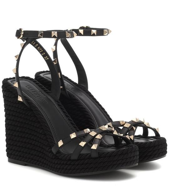 Valentino Garavani Rockstud Torchon leather wedge sandals in black