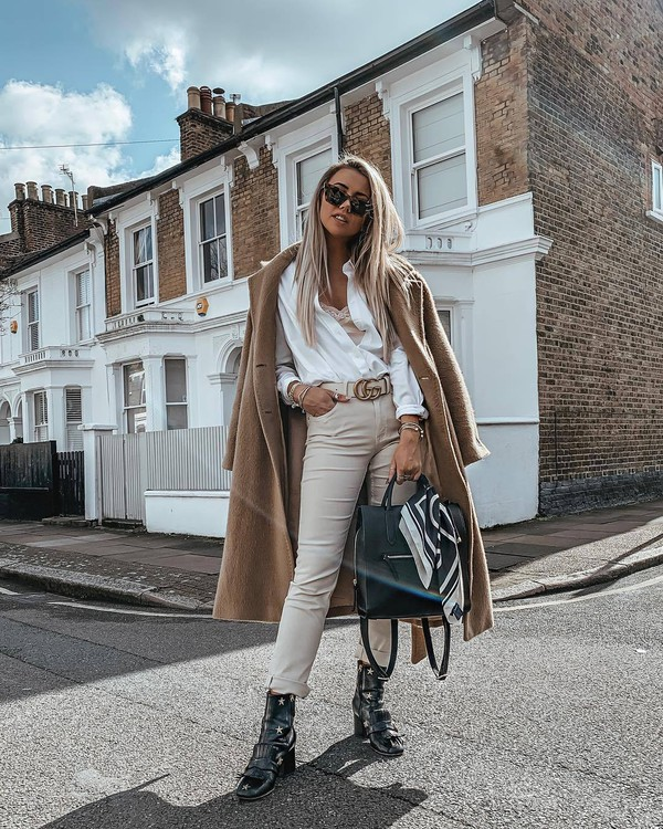 top white shirt skinny pants high waisted pants black boots ankle boots black bag camel coat underwear gucci belt