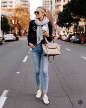 jeans,skinny jeans,white sneakers,shoulder bag,leather jacket,black jacket,scarf,black top,sunglasses