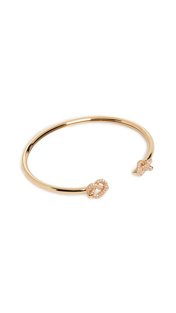 Kate Spade New York Loves Me Knot Pave Flex Cuff in gold / clear