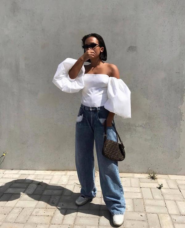 top off the shoulder top white top boyfriend jeans white shoes fendi bag