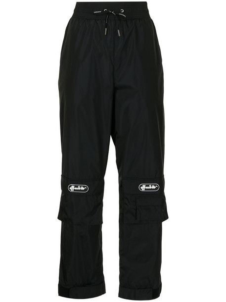 Off-White logo patch track pants in black