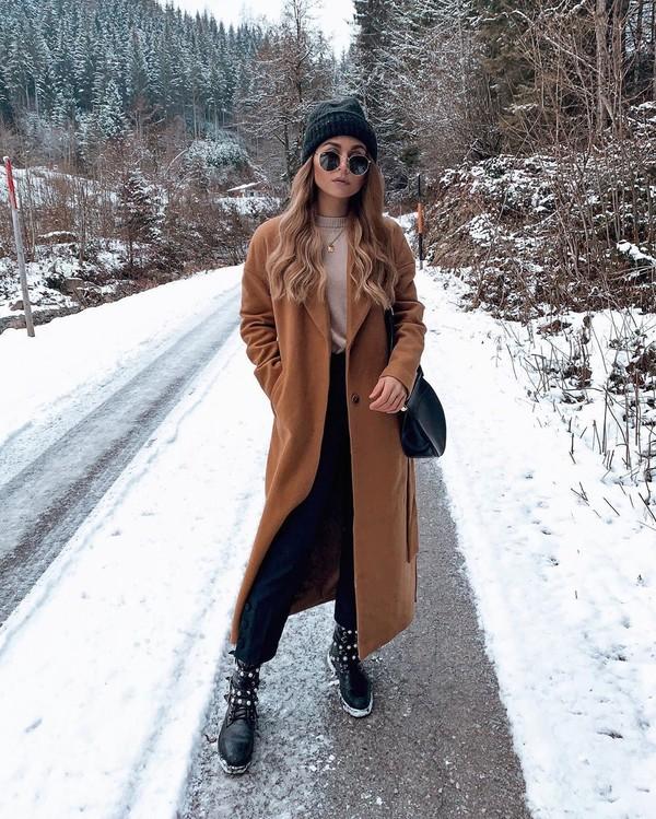 coat long coat ankle boots black boots black pants sweater beanie black bag