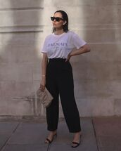 top,white t-shirt,balmain,black pants,high waisted pants,black sandals,handbag
