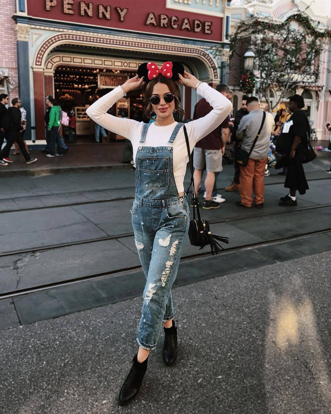 jumpsuit denim ripped ankle boots white top black bag sunglasses