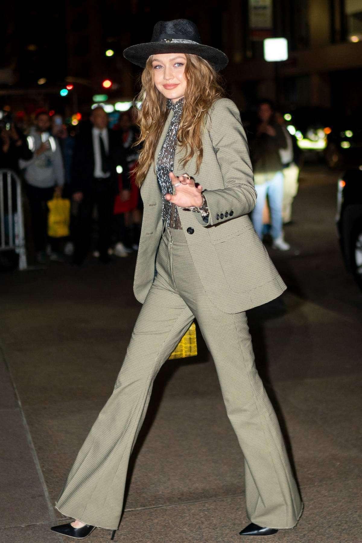 top blouse see through gigi hadid flare dress celebrity suit pants blazer model off-duty